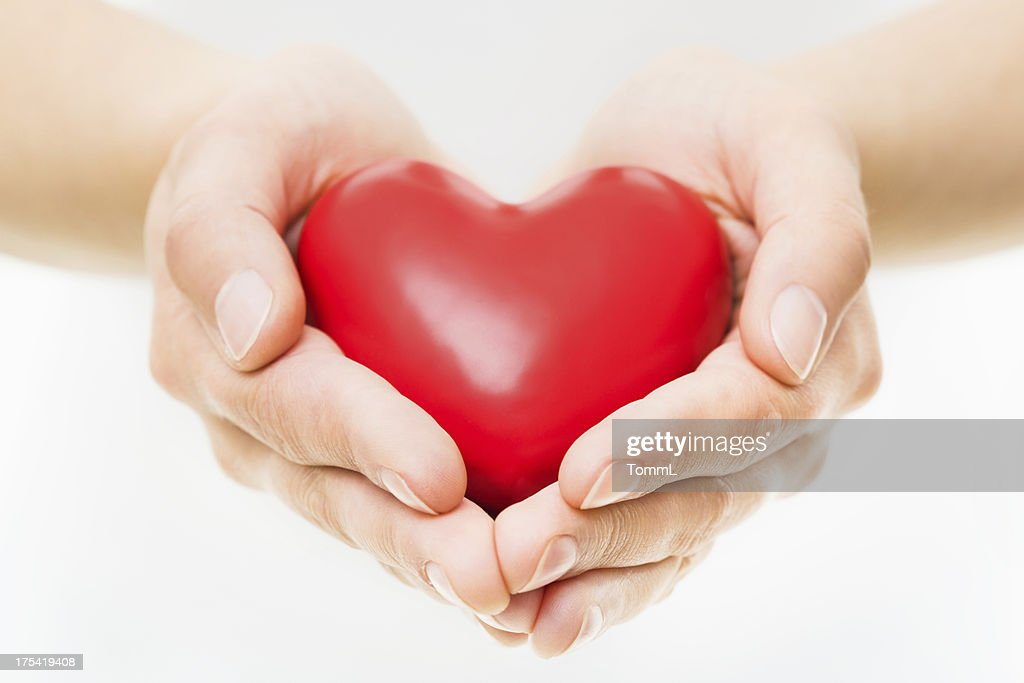 Hands Presenting Heart : Stock Photo