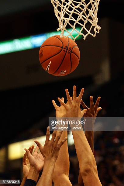 Hands reach for the ball during the Connecticut V Syracuse Semi Final match during the Big East Conference 2013 Women's Basketball Championships at...