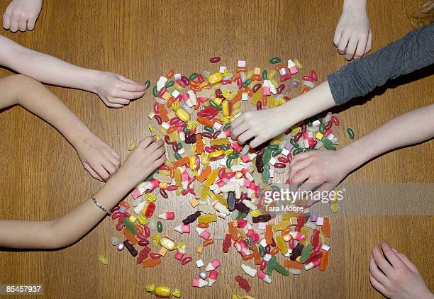 hands reaching for sweets