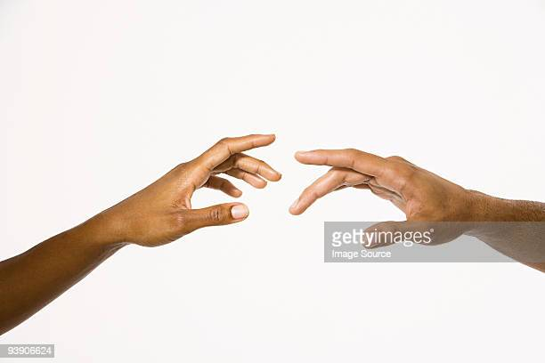 hands reaching out - african ethnicity stock pictures, royalty-free photos & images