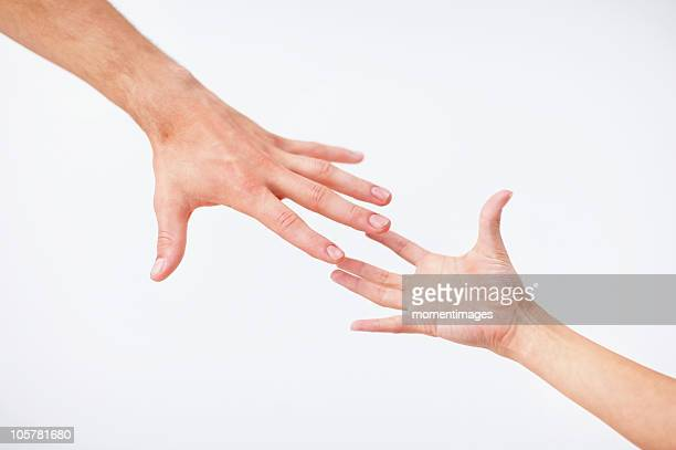 Hands reaching
