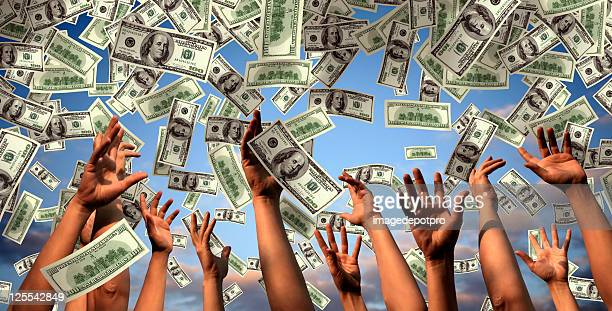 hands reaching to falling money - attending stock pictures, royalty-free photos & images