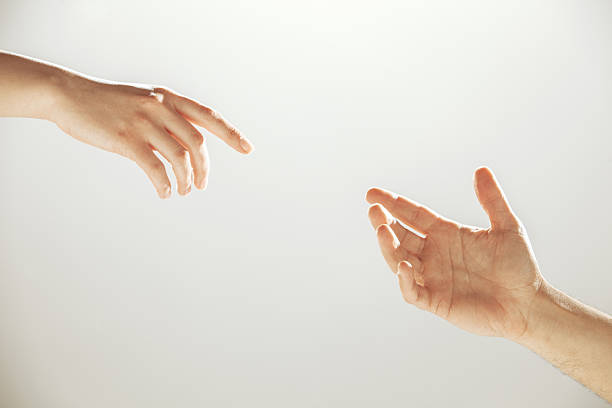hands reaching towards each other - hand stock pictures, royalty-free photos & images