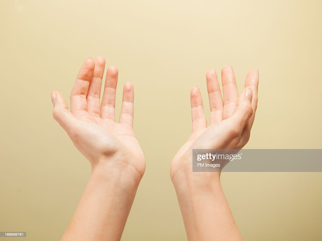 Hands reaching up to heaven : Stock Photo