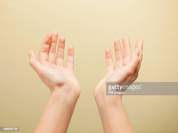 hands reaching up to heaven - reaching stock pictures, royalty-free photos & images