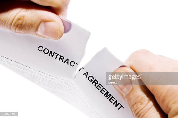 hands ripping contract agreement document - agreement stock pictures, royalty-free photos & images