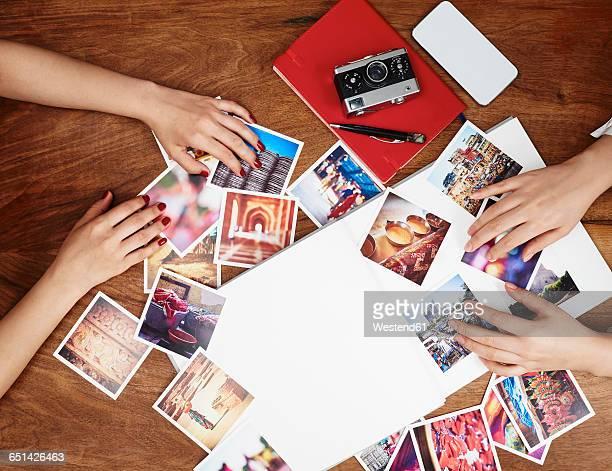 Hands sorting photo prints