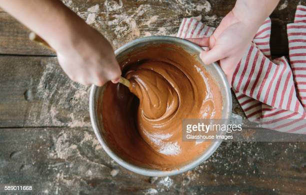 Hands Stirring Cake Batter in Bowl, High Angle View