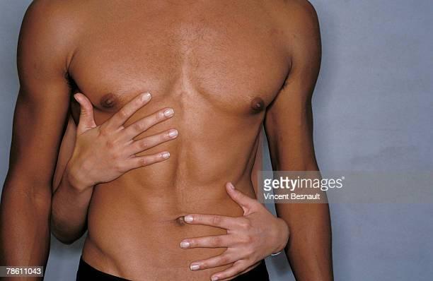 Hands stroking chest