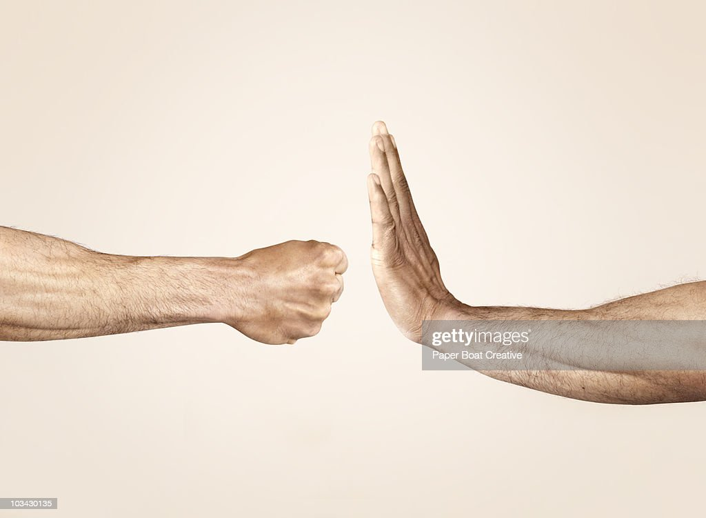 Hands symbolizing defensive and offensive force : Stock-Foto