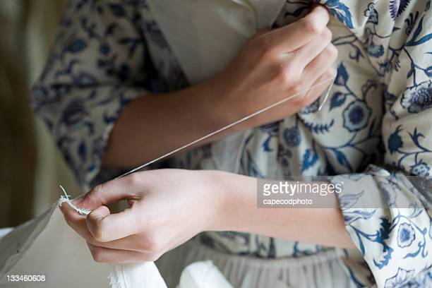 hands that sew - colonial style stock pictures, royalty-free photos & images