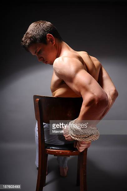 hands tied up - man tied to chair stock photos and pictures