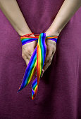 hands tied with rainbow ribbon lgbt