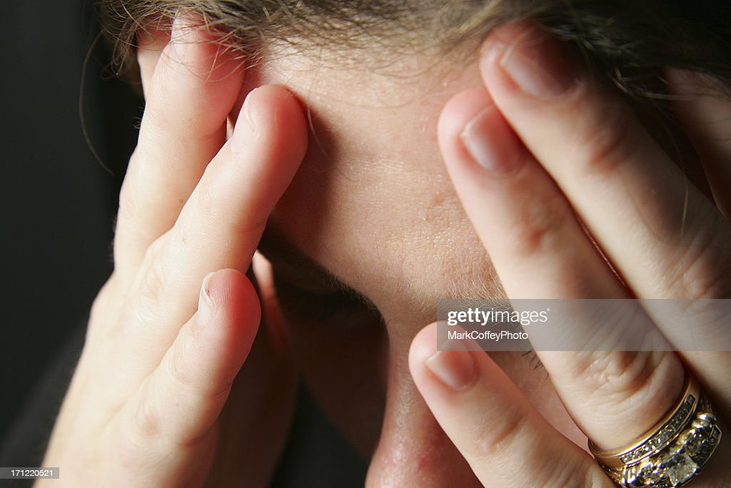 Hands to head with headache : Stock Photo