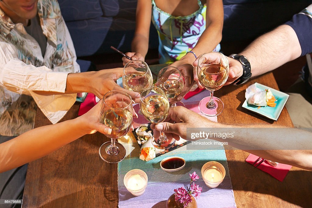 Hands toasting wine glasses : Stock Photo