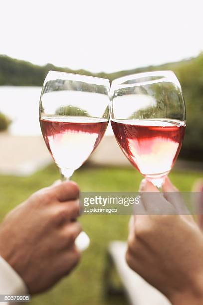 Hands toasting with wine