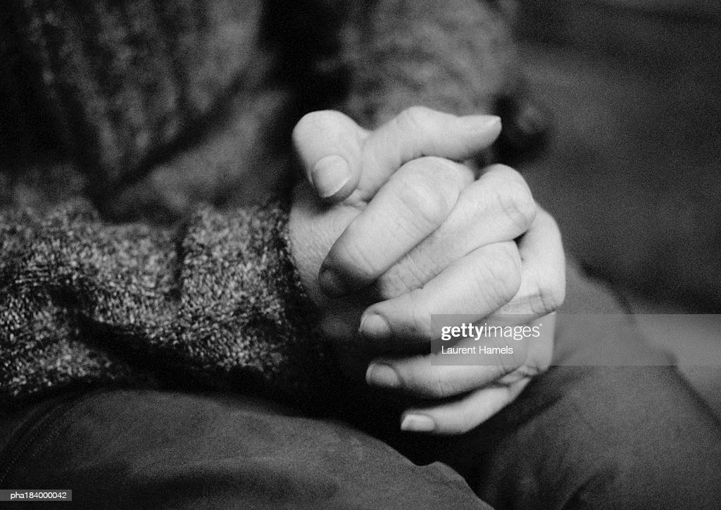 Hands together, close-up, b&w : Stockfoto