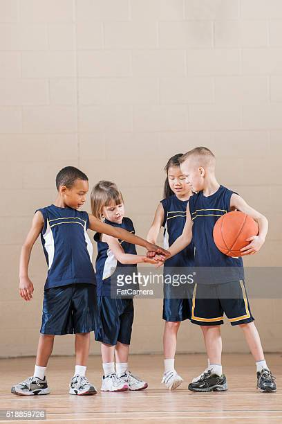 hands together in a huddle - basketball team stock pictures, royalty-free photos & images