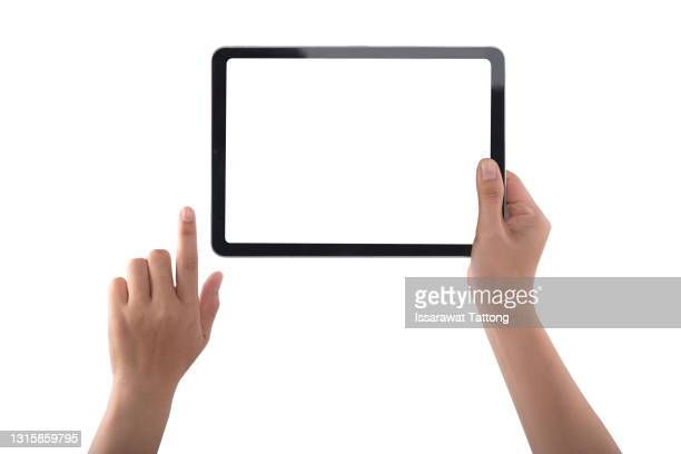 hands touching black tablet screen, isolated on white background - digital tablet stock pictures, royalty-free photos & images