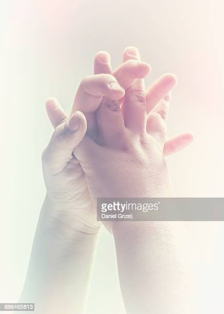 hands touching each other