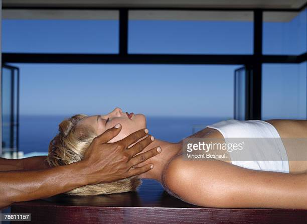 hands touching woman - black massage therapist stock photos and pictures