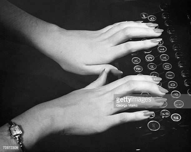 1950s: Hands typing.