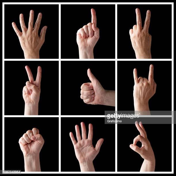 alza le mani più gesti della mano maschile isolati su sfondo nero - gesto con la mano foto e immagini stock