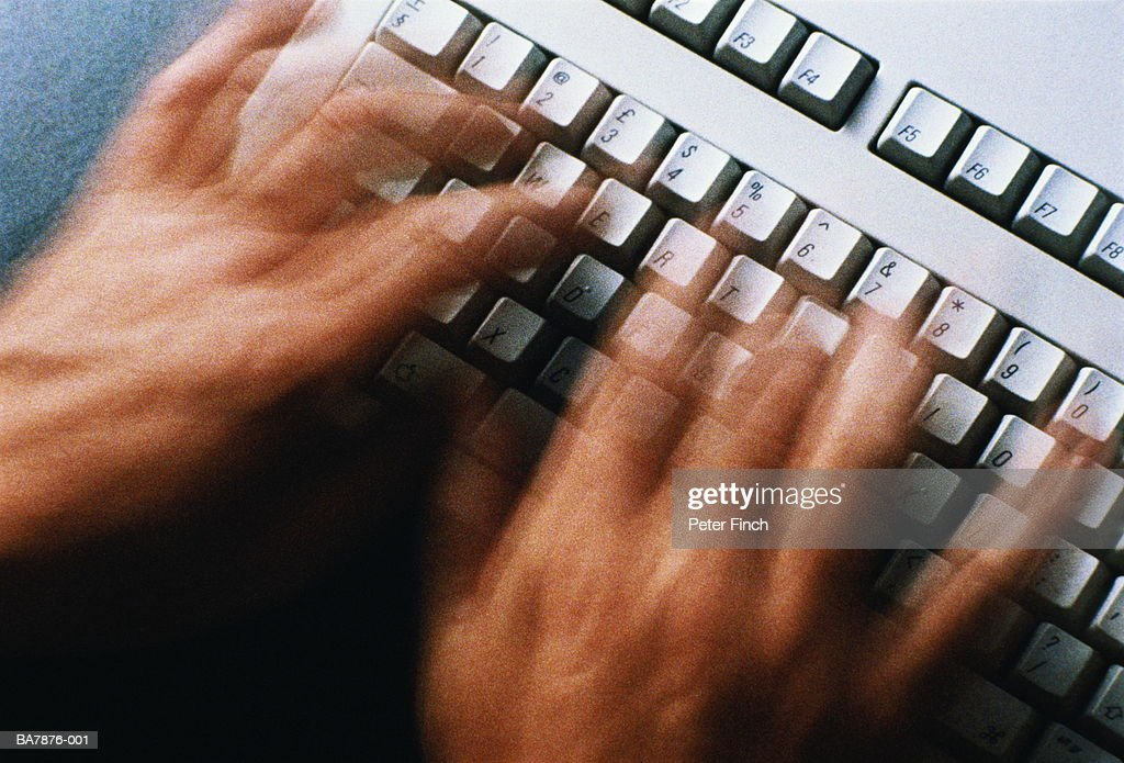 Hands using computer keyboard, close-up (blurred motion) : Stock Photo
