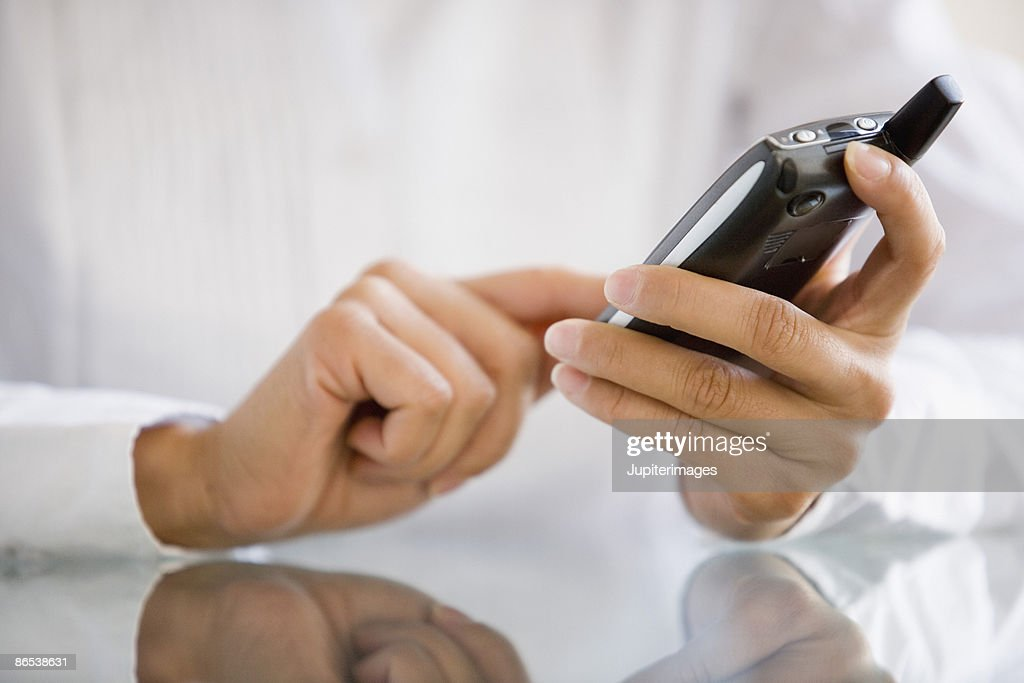 Hands using PDA : Stock Photo