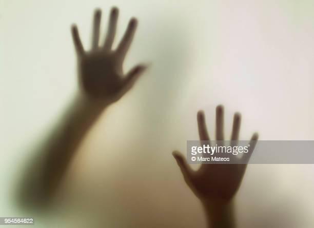 hands viewed from a smoky glass - marc mateos fotografías e imágenes de stock