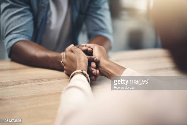 hands were made to care for each other - emotional support stock pictures, royalty-free photos & images