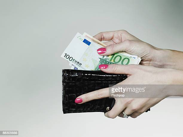 Hands with billfold and money