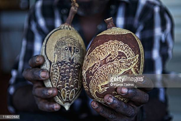 Hands with carved boab nuts.