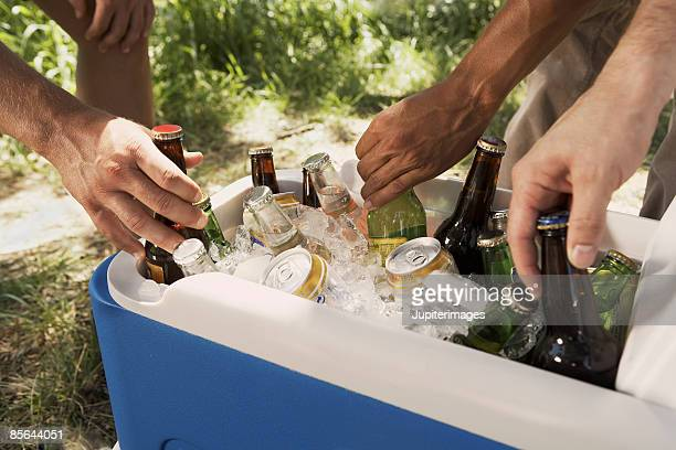 Hands with cooler and drinks