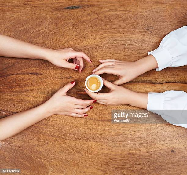 Hands with espresso cup