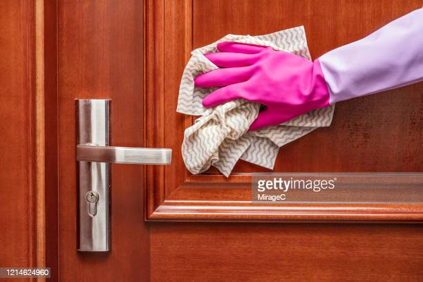 hands with glove wiping door surface with disinfection wipes - glove stock pictures, royalty-free photos & images
