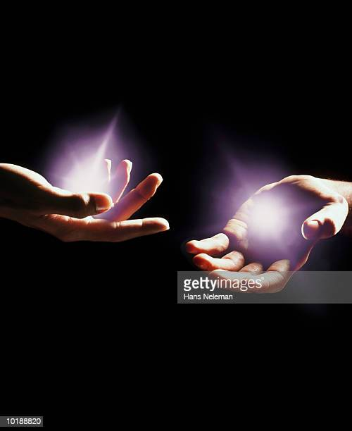 Hands with light emminating from them