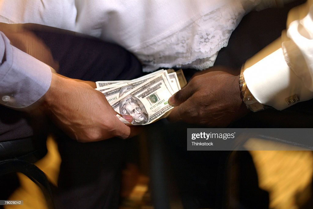 Hands with money : Stock Photo
