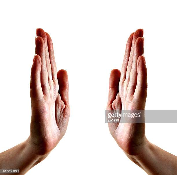 2 hands with palms facing each other about to high five