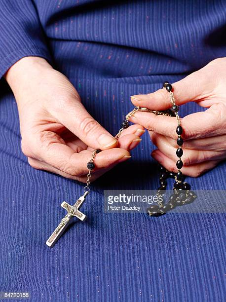hands with rosary and crucifix - nun stock pictures, royalty-free photos & images