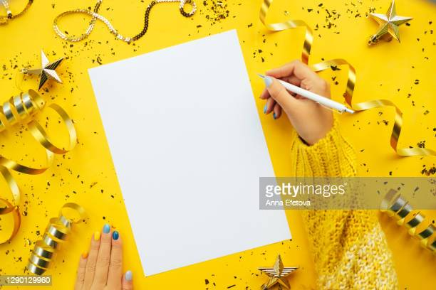 hands writing new year goals - new year stock pictures, royalty-free photos & images