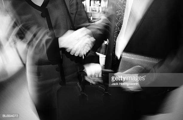 Handshake and Luggage Blur