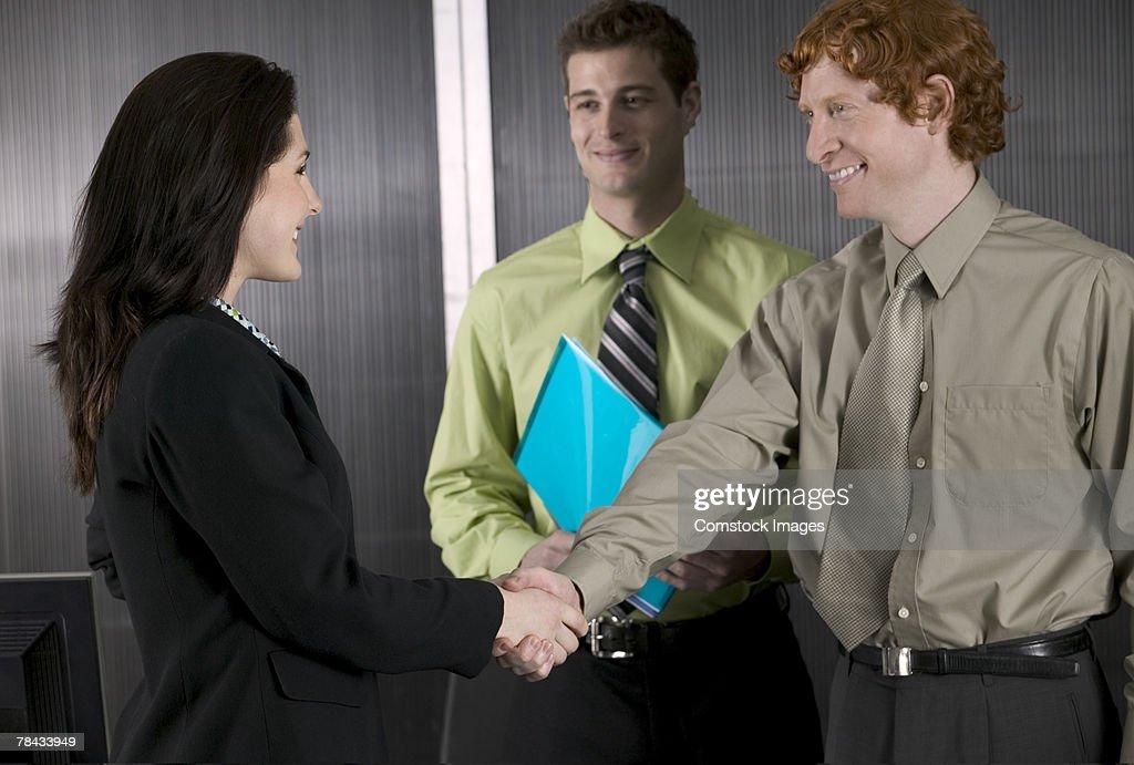 Handshake between business colleagues : Stockfoto