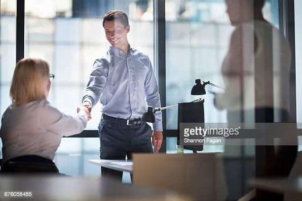 Handshake between two colleagues in offce