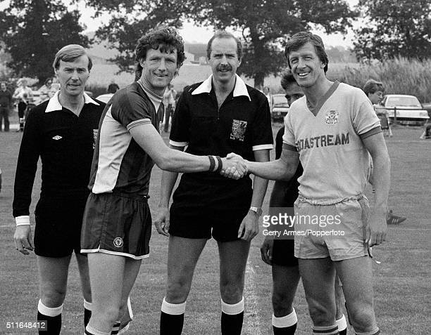 A handshake by the captains of Aston Villa and Peterborough United prior to a preseason friendly at Bodymoor Heath near Birmingham 5th August 1983 On...