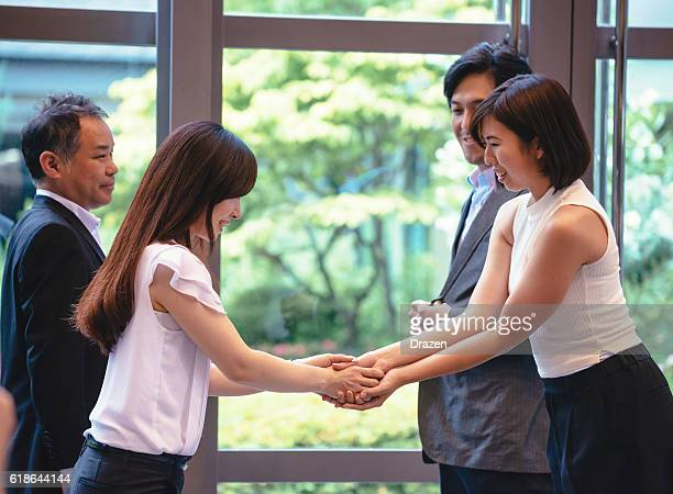 Handshake for new business in Japanese business