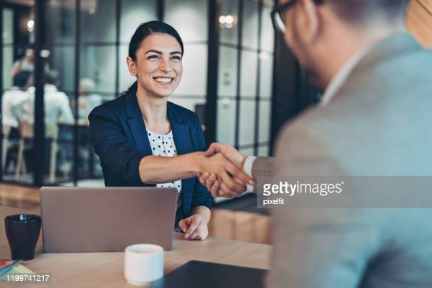 handshake for the new agreement - bonding stock pictures, royalty-free photos & images