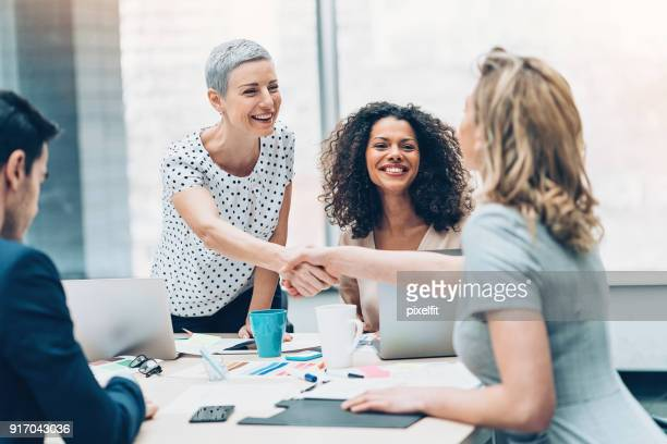 handshake for the new contract - trust stock pictures, royalty-free photos & images