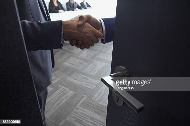 Handshake in office meeting room