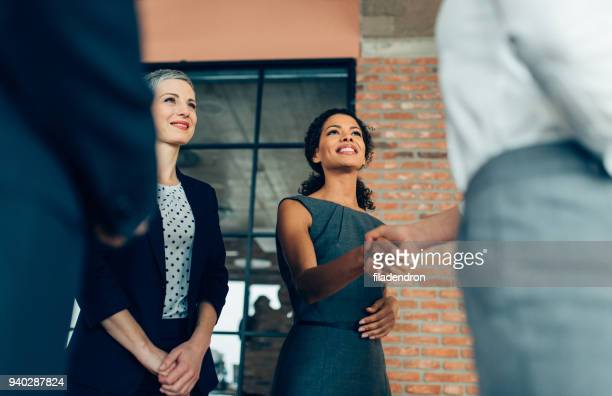 handshake of business people - connection stock pictures, royalty-free photos & images